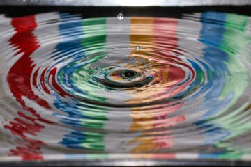 photo of multi-colored water rippling